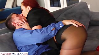 On fire red haired woman Kelly Divine gets her pussy fucked in beat-up pantyhose
