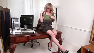 Dirty mature Elizabeth Green moans to the fullest masturbating in the office