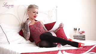 Sassy tattooed bitch Becky Holt gets naked and tells erotic N